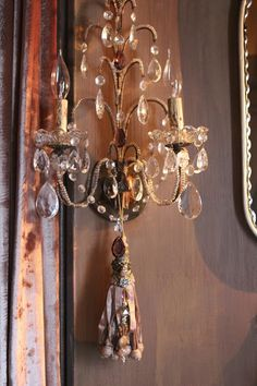 The tassel adds a lovely detail to an already beautiful light fixture.