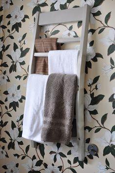 Great re-purposing idea: chair back as towel rack