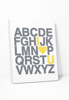 Alphabet print in gray with yellow letters that spell I Love You. More colors in the shop. GALLERY WRAPPED CANVAS: Printed on canvas then stretched and wrapped around wood bars - ready to hang, no nee