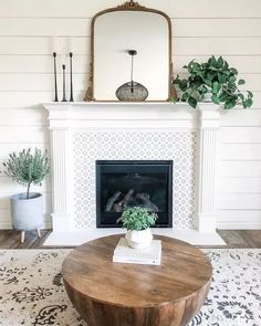 farmhouse living room design with rustic coffee table and white tile fireplace, fireplace decor in rustic family room design, neutral living room decor Living Room Decor Fireplace, Living Room Mirrors, My Living Room, Farmhouse Fireplace, Home Fireplace, Fireplace Design, Fireplaces, Fireplace Mirror, Mirror Over Mantle