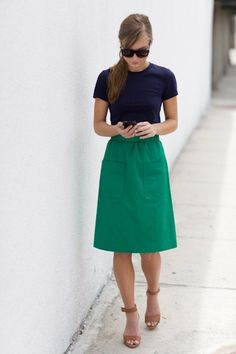 Navy tee, green skirt and nude strappy sandals.