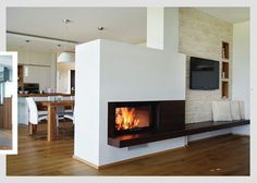 Modern fireplace as a room divider. The tunnel chimney forms the ideal center . Modern fireplace as a room divider. The tunnel chimney forms the ideal focal point in your living room and offers a view. Living Room Decor Fireplace, Bookshelves In Living Room, Fireplace Wall, Fireplace Design, Fireplace Ideas, Farmhouse Fireplace, Modern Fireplace, Farmhouse Interior, Quinta Interior