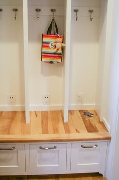 outlets in mudroom cubbies for charging electronics, shoes in the drawers below || Sawdust Girl