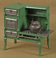 "Kenton cast iron Kent toy gas stove with a steel tea kettle, 9 1/2"" h., 9 3/4"" w. Estimated auction value: $150 - $250"