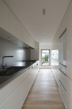 Concrete House With Sculptural Gable Makes the Most of a Compact Site - Curbed Long Narrow Kitchen, Big Kitchen, Kitchen Items, Kitchen Decor, Roof Design, Küchen Design, Interior Design, Counter Design, Modular Furniture