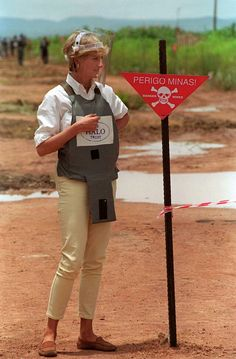 Wearing protective body armor and a visor, Diana, Princess of Wales, visits a minefield being cleared by the charity Halo in Huambo, Angola, January 15, 1997.