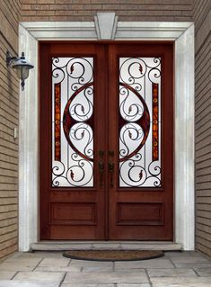 Iron Entry Doors   Double wood door with wrought iron inserts