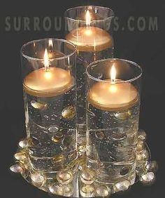 silver and gold round floating candles – wedding centerpieces Silver Centerpiece, Floating Candle Centerpieces, Party Centerpieces, Flower Centerpieces, Black And Gold Centerpieces, Centerpiece Ideas, Inexpensive Wedding Venues, Unique Weddings, Budget Wedding