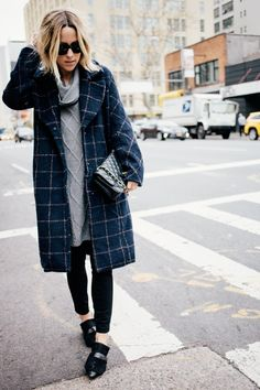 Throw on a sweater dress and blanket coat to look effortlessly chic on your days of running errands around the city. @damselindior