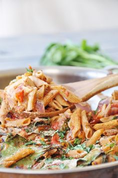 Vegan Penne Pasta Casserole. Filled with spinach, basil, red onion, garlic, cashew cream, and whole grain penne pasta.