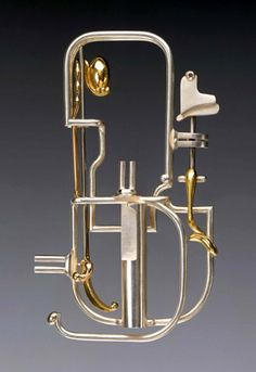 "Labyrinth - Brooch  sterling silver, 14k gold   3½"" x 2"" x ½"", 1997           tommuir@hughes.net"