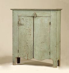 """Cowan's Auctions: mixed woods, with 3 shelves, 2 doors, and cutout feet and ends. Retains a fantastic, old, blue-painted surface, and a scrubbed top with a great patina. Found in Ohio, probably mid-19th century; 50"""" high x 41"""" wide x 14.5"""" deep."""