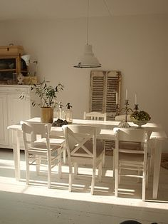 Love the simple elegance of this room. Note the shutters against the wall.