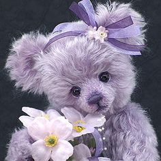 Florrie by Teddy Kingdom. She is beautiful, love the color lilac.  I have a pink one similar to this one.