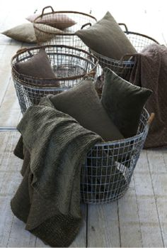 vintage metal baskets for blanket/pillow storage.