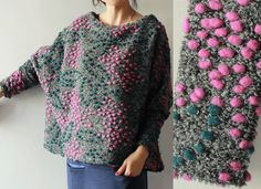 On a boucle background sweater, either purchased or handknit thread roving through to make random patterns