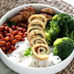 A delicious recipe for rice noodles with marinated chicken, vegetables and parsley omelette rolls.