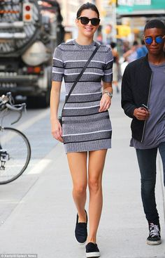 Kendall Jenner showed off her long, lean legs in a black and white patterned mini dress as she strolled around New York's Soho neighbourhood
