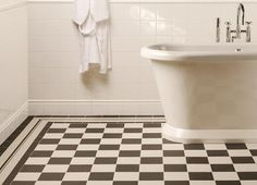black and white checkerboard tiles with monochrome border - very elegant