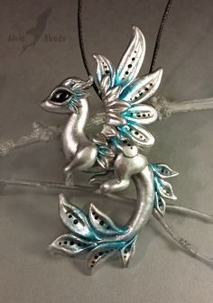 Silver arctic dawn dragon by AlviaAlcedo on DeviantArt Made of polymer clay. Covered by a glossy lacquer.