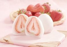 Frozen yogurt covered strawberries.