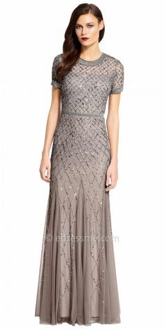 Dance the night away at your next special event in this Sequin Embellished Short Sleeve Evening Dress by Adrianna Papell. This style features a diamond print lattice sequin embellishment that cascades down do the hemline, a center back zipper with a keyhole slit, and godets on the column silhouette skirt. #edressme