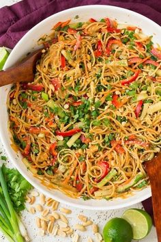 SPICY THAI PEANUT NOODLES == Peanut Sauce 1/2 cup creamy peanut butter 1/4 cup warm water 3 T soy sauce 2 T honey 2 T Sriracha (more or less to taste) 2 T fresh lime juice 1 1/2 T peeled and minced fresh ginger 1 T minced garlic 1 T sesame oil =====
