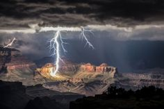 A photographer who set up for some sunset snaps caught an electrifying moment in nature amid America's awe-inspiring Grand Canyon. Rolf Maeder's photos from the south rim show multiple bolts lighting up an atmospheric stormy sky and connecting it to the famous Arizona landmark. He used a long exposure to capture several lightning strikes at […]