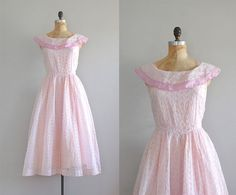 1950's lavender-pink sheer organdy eyelet dress with wide portrait collar, lavender-pink acetate slip layer, princess seamed bodice, fitted waist and long full skirt. Metal side zipper.