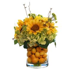 Silk sunflower arrangement with citrus accents in a glass planter.  Product: Faux floral arrangementConstruction Mat...