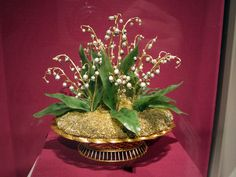 Imperial Lilies-of-the-Valley Basket. yellow and green gold, silver, nephrite, pearl, rose-cut diamond.  House of Faberge  Workmaster: August Wilhelm Holstrom (Finnish, 1828-1903)