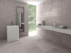Tegels voor de wand en vloer van de badkamer. Met de looks van beton en het onderhoudsgemak van keramische tegels. Sphinx tegels via sanidrome