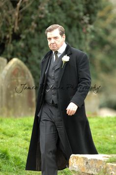 James Wildman Photography | Filming Downton Abbey Series 6 in Bampton | Mr Bates (with a wedding buttonhole flower?)