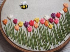 Your place to buy and sell all things handmade : Tulip Field Embroidery Hoop Art Tulip Embroidery Floral Hand Embroidery Patterns Flowers, Hand Embroidery Videos, Embroidery Stitches Tutorial, Embroidery Flowers Pattern, Embroidery Hoop Art, Hand Embroidery Designs, Embroidery Jewelry, Etsy Embroidery, Embroidery For Beginners