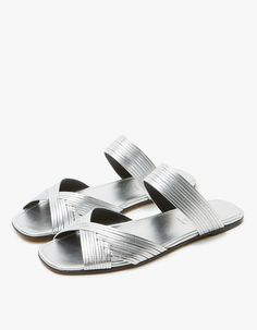 Sandal from Alumnae in Silver. Slips on. White leather upper crafted from slim bands. Open square toe. Crisscross detail at vamp. Strap across forefoot. Leather sole. • Leather • Made in Italy
