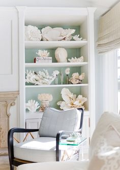 The shelves of the family room are adorned with large pieces of lettuce coral! Notice the sea foam green tone that backs the built-ins - wonderful!    Checkout more @ http://segretosecrets.squarespace.com/