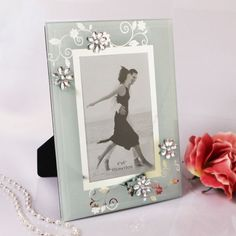 """Pick a flower or two with Ruby Blanc's """"Blossoming Memories"""" photo frame! This stunning glass frame will look fantastic on the your event's tables and in your guests homes. Give them a smile as well as a fantastic frame they will treasure forever! #weddingfavors"""