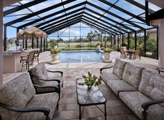 The perfect indoor/outdoor living combination by the pool at Jupiter Country Club, Florida.