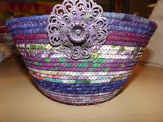 tall round purples basket showing front detail