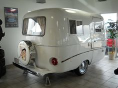 love the white boler.....and wish I had a garage like this!