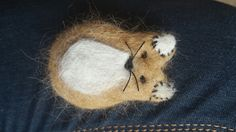 A fox made out of dig hair