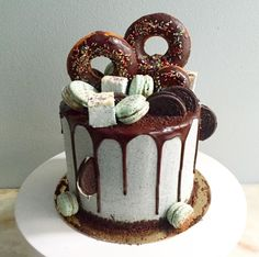 now that's a cake!  donuts and oreos and macarons! oh my!  ~  we ❤ this! moncheribridals.com