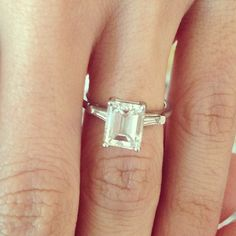 This looks like my moms, except the 2 side stones are round. I hope to wear hers one day.
