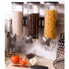 The wall-mounted SmartSpace Dispenser helps you keep kitchen counters clear.  Use instead of old fashioned flour/sugar/tea/coffee cannisters or for other space hogging, frequently used items like cereal or pet food .  $47 http://store.yankodesign.com/home-and-office/smartspace-food-dispenser-wall-mount-by-zevro#