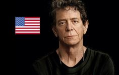 """Lou Reed - """"Take a walk on the wild side""""  At that point a door to the left of the stage opens and Lou Reed comes walking on, followed by two man. He walks straight to the chairs with the microphone and sits down. The room is echoes with the sound of shutters clicking and camera flashes.  """"This feels strange,"""" Reed starts, """"it feels like I'm in the enemy camp. Advertising has always been the polar opposite of rock and poetry. And here I am, at an advertising festival!"""