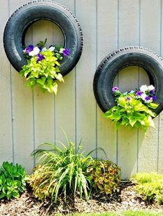 If using an entire car as a flowerpot is a bit too much for you, then why not use some old tires? You can even paint them, if you want.