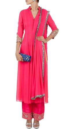 This anarkali salwar kameez featuring in a neon pink georgette kurta with mirror work on collar, tilla embroidered cuff, embroidered front buttons and lime green georgette side slits. It is teamed wit