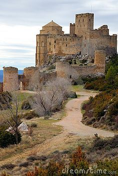 Castillo de Loarre, Huesca, Spain - I've been there and the view from that top turret is so amazing! You can see for miles!!