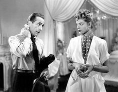 Humphrey Bogart  como Philip Marlowe y Laruen Bacall en El sueño Eterno 1946