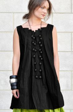 STEP TOP by KALIYANA Sleeveless, A-line tunic with extended pleated neckline in both front and back.